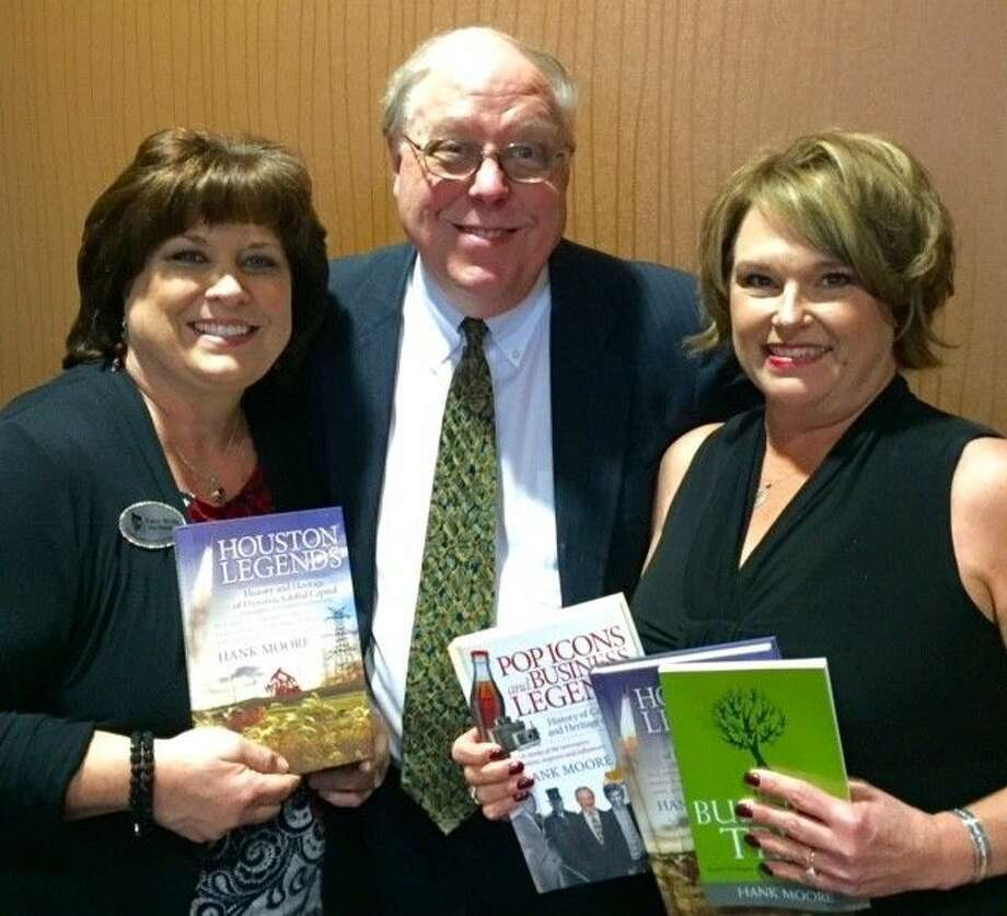 "Hank Moore, author of the book ""Houston Legends"" served as the guest speaker at the Friendswood Chamber of Commerce Luncheon Thursday (Feb. 4). From left: Chamber Vice President Lucy Woltz, Hank Moore, Kelly Idoux of Altered Images. Photo: File Photo"
