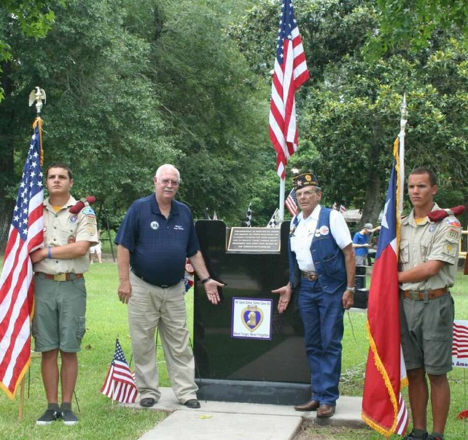 Roman Forest Mayor Ray Ricks, along with Joe Piazza and local Boy Scouts, hosted a rededication ceremony for the Purple Heart monument on July 4. Photo: STEPHANIE BUCKNER