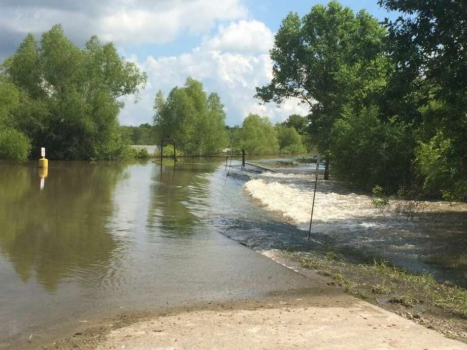 Roads inside of the Trinity River National Wildlife Refuge are covered by water. Normally only 5 percent of the area inside the refuge is covered by water. The recent rains have reversed that. Now only 5 percent of the refuge isn't covered by water. Photo: Courtesy Photo