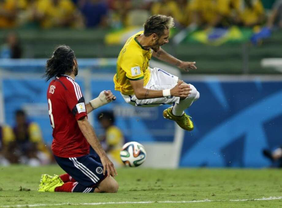 Brazil's Neymar is airborne after colliding with Colombia's Mario Yepes during the World Cup quarterfinal soccer match. Brazil won 2-1 to reach the semifinals``