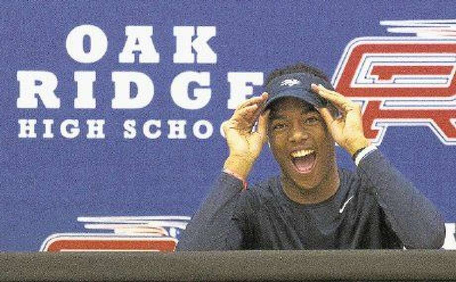 Oak Ridge's Daylon Johnson reacts as the crowd cheers during a signing day ceremony Wednesday, Feb. 3, 2016. Johnson signed to play football at the University of Nevada. To purchase this photo and others like it, go to HCNpics.com. Photo: Jason Fochtman