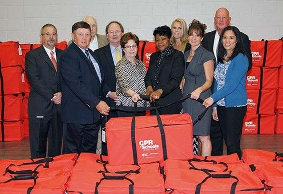 Representatives from the Tomball Regional Health Foundation presented Tomball ISD's Director of Administrative Services Karen Chlebo and Director of Nursing Cathy Pool with nine CPR training kits for use in Tomball ISD. First row from left, Jack Smith, Latrell Shannon, Ellen Stutts, Chlebo, Pool, (second row) Ralph Foxworthy, Jerry Till, Rick Pritchett, Marilyn Kinyo and Lynn LeBouef. Photo: Tomball ISD