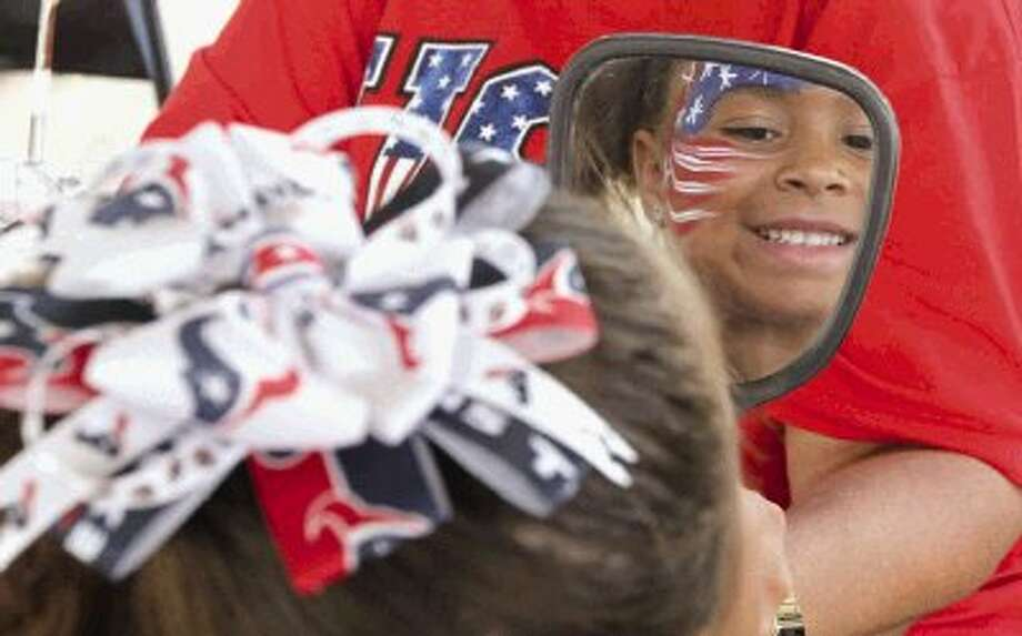 Diana Barnes gets her face painted during the Red, Hot and Blue Festival in The Woodlands Friday. To view or purchase this photo and others like it, visit HCNpics.com. Photo: Jason Fochtman / Conroe Courier