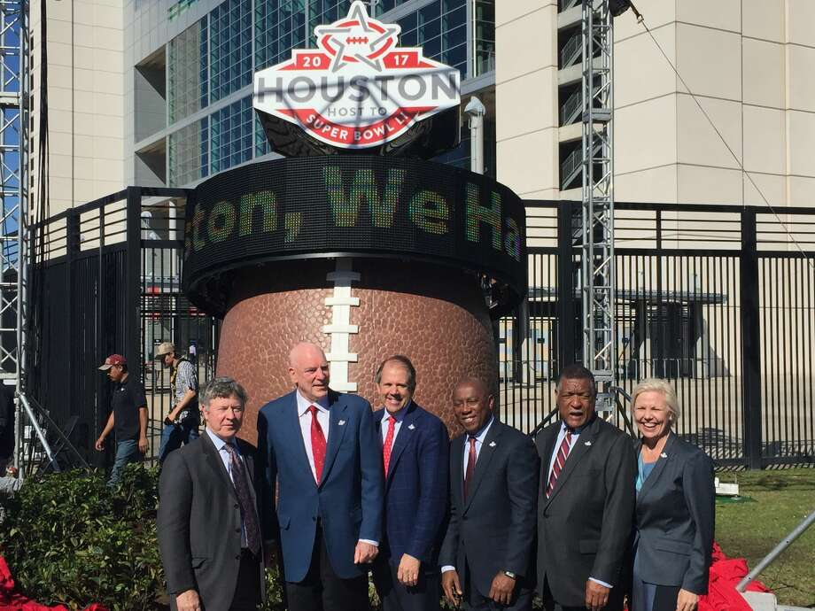 Members of the Super Bowl LI Committee pose for a picture with the new countdown clock that was unveiled on Thursday, Feb. 11, 2016, at NRG Stadium. From left to right, Harris County Judge Ed Emmett, Houston Texans Founder and CEO Bob McNair, Houston Super Bowl Host Committee Chairman Ric Campo and City of Houston Mayor Sylvester Turner, Harris County Precinct One Commissioner Gene Locke and Host Committee President and CEO Sallie Sargent. Photo: Joshua Koch