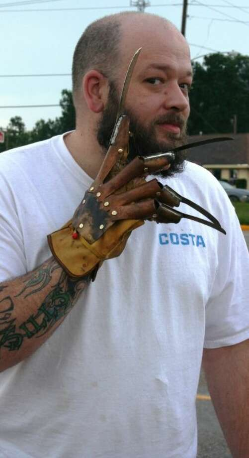 The infamous mechanical hand from the Nightmare on Elm Street film series has been recreated by Splendora resident Brian Sills many times as part of his prop business, Demented Glove Works.