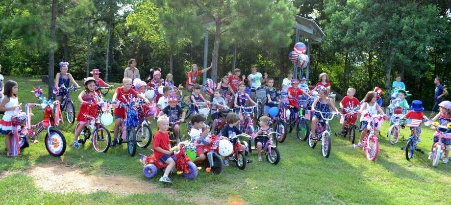 Kids ages pre-K to 13 are invited to join the popular Bicycle/Tricycle ... and Scooter Parade at the Magnolia Fourth in Unity Park. Prizes will be awarded for first place. Photo: Submitted Photo