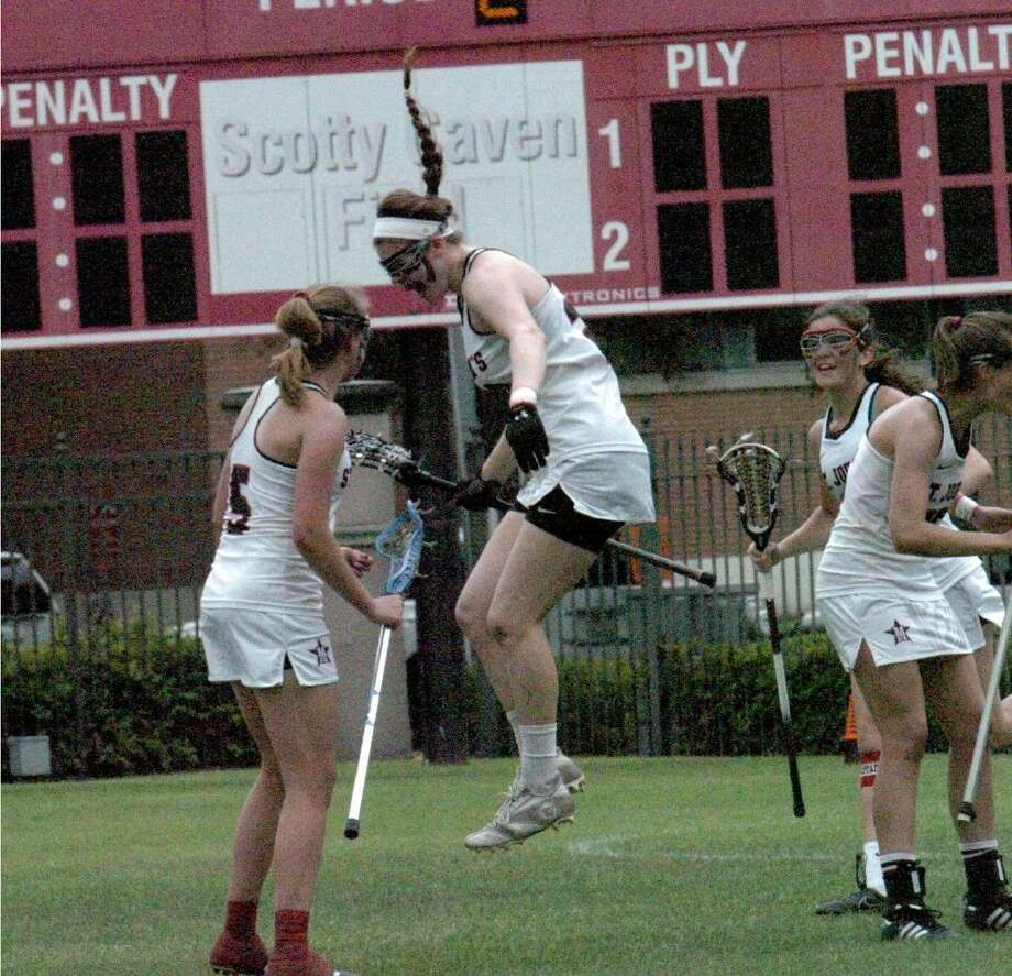 A St. John's girl celebrates a goal scored by the home team during the Mavericks' recent unbeaten season that saw them win both the SPC and Texas High School Lacrosse League girls' state championship. The Mavericks also had a trio of girls who were named All-American for their play this spring.