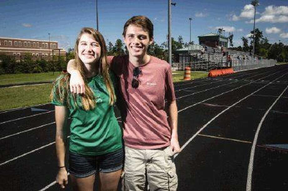 Brother and sister track and cross country duo Georgia and Cooper Burner pose for a portrait at College Park High School.