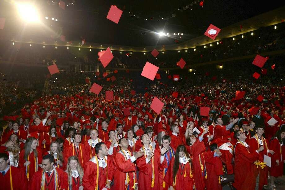 Members of the Langham Creek High School Class of 2015 toss their caps into the air after being declared graduates on June 5 at the Berry Center.