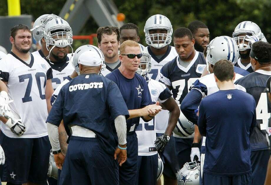 Dallas Cowboys head coach Jason Garrett, center, talks with the team during an NFL football minicamp Tuesday in Irving.