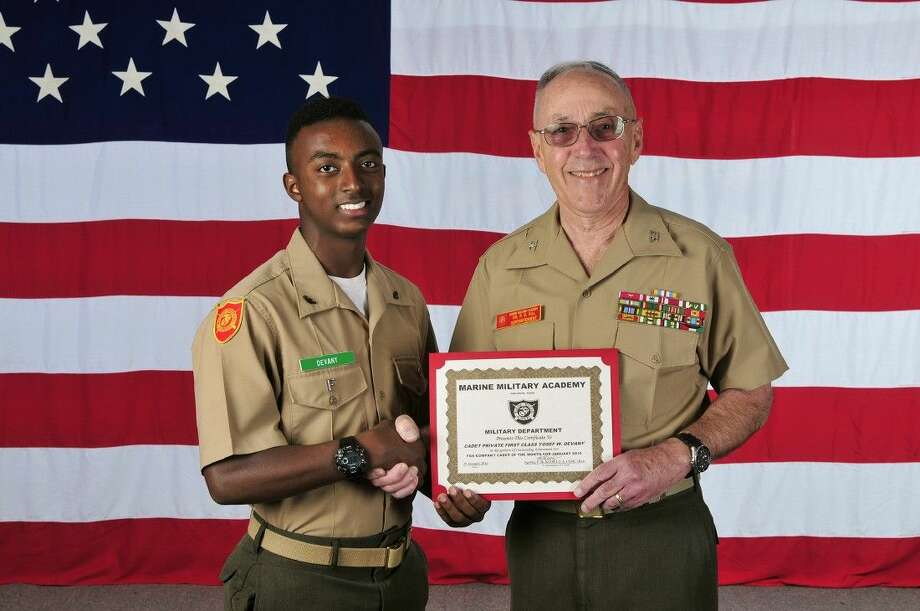 Marine Military Academy eighth-grader Yosef Devany of Katy, Texas, accepts the Marine Military Academy January 2016 Cadet of the Month award from Superintendent Col R. Glenn Hill.