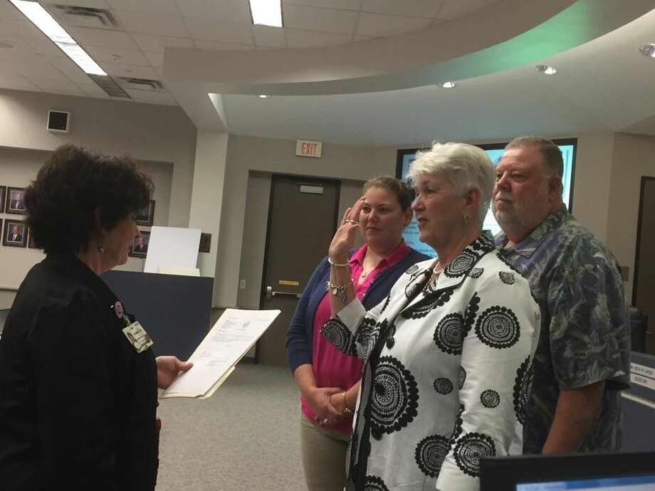 Nancy Morrison, center, was officially sworn in as an Humble ISD board member during the June 9, 2015 board meeting.
