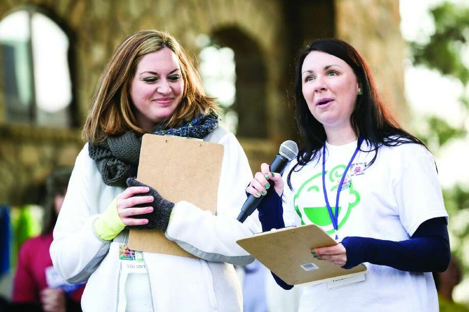 Race director Leah Yeglin, right, and organizer Tamara Ayers, left, speak during the Cleft Smiles 5K Family Fun Run / Walk March 7, 2015 at Rob Fleming Park. About 650 participants raised $25,000 for Operation Smile, more than double the original goal of 10,000. Yeglin hopes to raise $35,000 at this year's event, scheduled for Feb. 27 at Rob Fleming Park. Photo: Michael Minasi