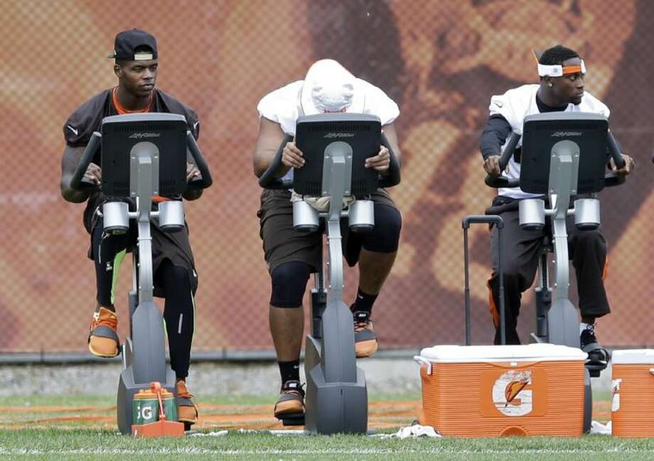 Cleveland Browns wide receiver Josh Gordon, left, rides a stationary bike during a mandatory minicamp practice on June 11 in Berea, Ohio.