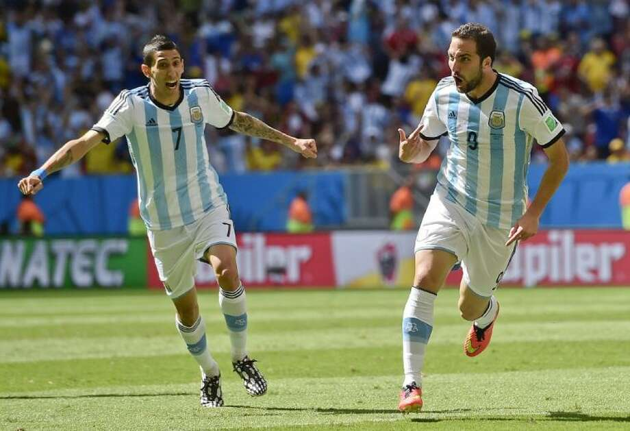 Argentina's Gonzalo Higuaín, right, celebrates with Ángel di María after scoring against Belgium on Saturday in a World Cup quarterfinal match at the Estádio Nacional in Brasília, Brazil.