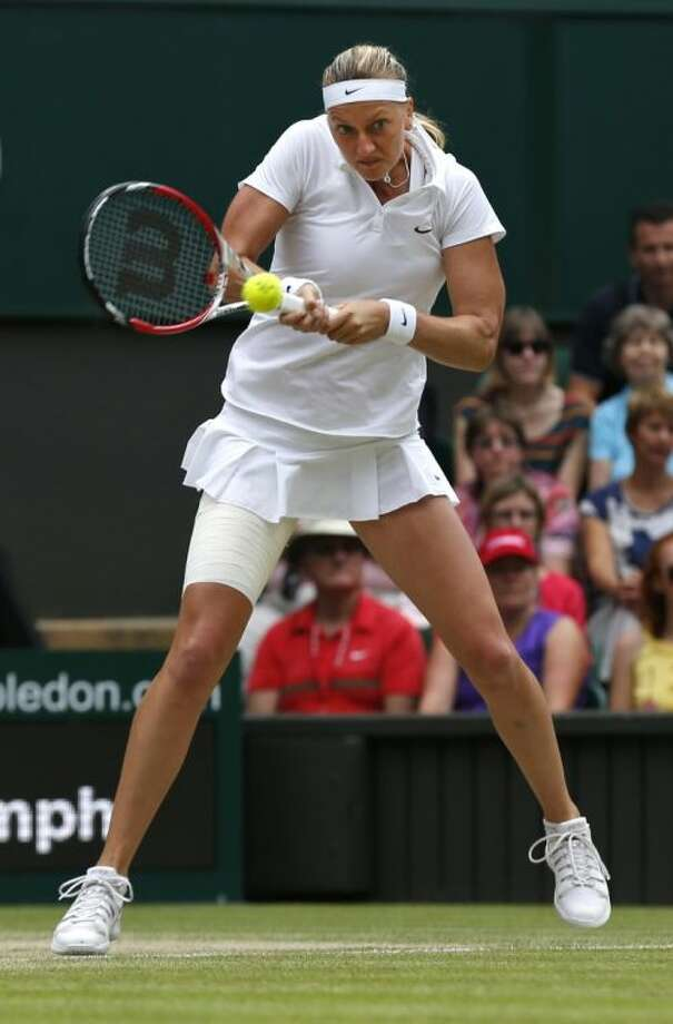 Petra Kvitová of the Czech Republic plays a return against Eugenie Bouchard of Canada during the women's singles final on Saturday at the All England Lawn Tennis Championships in Wimbledon, London.