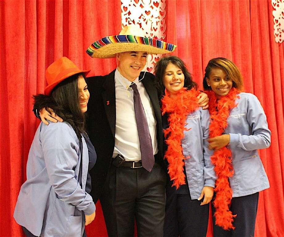 Dr. Sdringola had fun in the photo booth with PMC employees.