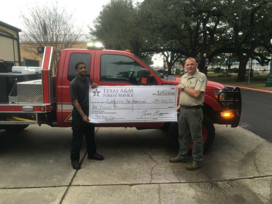 Pictured are Roy Edward, League City VFD Firefighter and Jeremy Wagner AEM, Texas A&M Forest Service.
