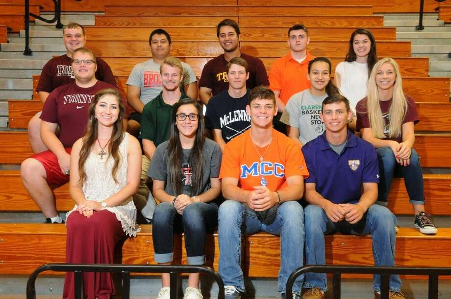 Athletes from Tomball High School recently signed their letters of intent to continue their athletic careers in college. Pictured here are Madison Link, Lauren Pettinati, Kiana Workman, Joe Breaux, Robbie Gillen, William McElvogue, Harrison Heim, Tyler Uhig, Skye Roach, Tara Jenkins, Riley Quigley, Rico Santana, Stephen Bonnain, Zach Cummings and Megan Shoemaker. Photo: Photographer