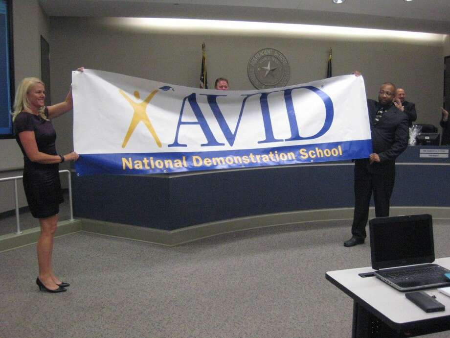Sally Wagner and Henry Phipps surprised the Humble ISD school board with the announcement that Humble Middle School was named an AVID Demonstration School Feb. 9, 2016.