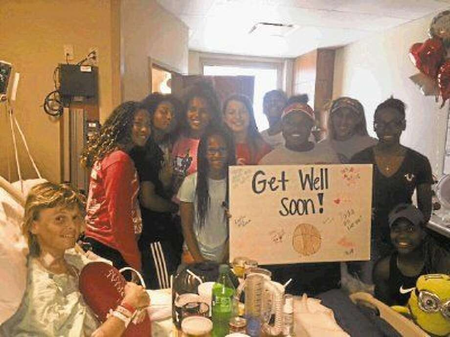 Crosby coach Michelle Trotter is visited by her team days after having heart surgery in July.