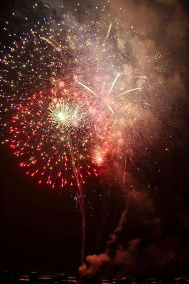 Fireworks light up the sky over the Pasadena Convention Center and Fairgrounds during the City of Pasadena's annual 4th Fest Friday, July 4. Photo: KIRK SIDES