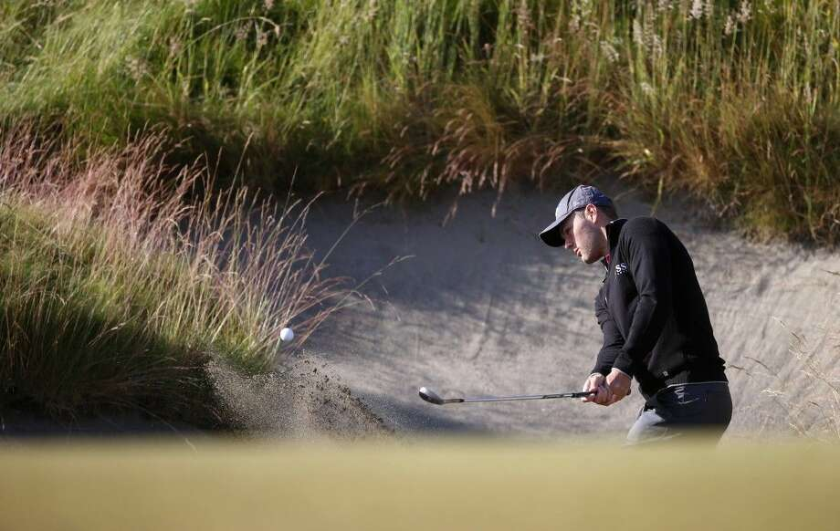 Martin Kaymer hits out of the bunker on the 10th hole during a practice round for the U.S. Open golf tournament at Chambers Bay on Wednesday in University Place, Wash.