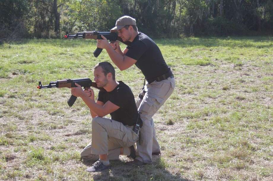 Two students at Praetorian Bodyguards-Texas go through training exercises to prepare them for jobs in the security industry. The bodyguard company moved to the Tarkington last year. Photo: Vanesa Brashier