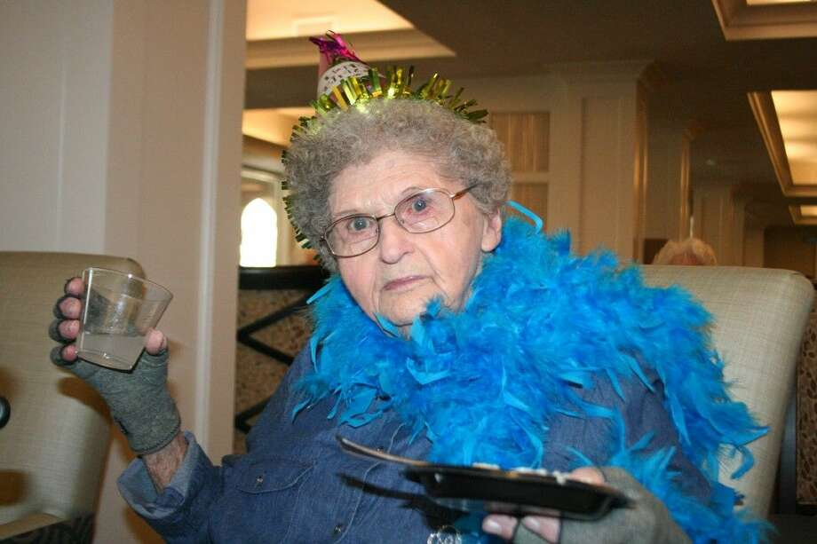 Arbor Terrace at Kingwood Town Center resident Vivian Miller donned a blue boa during her 100th birthday celebration Feb. 12, 2016.
