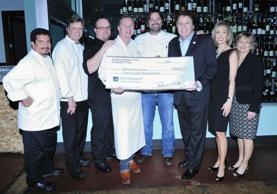 Pictured left to right are: Chef Arturo Osorio, Amerigo's Grille; Chef Mark Cox, MARK'S American Cuisine; Chef Brian McNamara, Jasper's; Chef Charles Clark, Ibiza Food & Wine Bar; Chef Bryan Caswell, REEF Restaurant; Lou Palma, President/Executive Director, Boys & Girls Country; Kim Marling, Executive Director/Vice President Board of Directors, Woodforest Charitable Foundation; and Vicki Richmond, Treasurer Board of Directors, Woodforest Charitable Foundation.