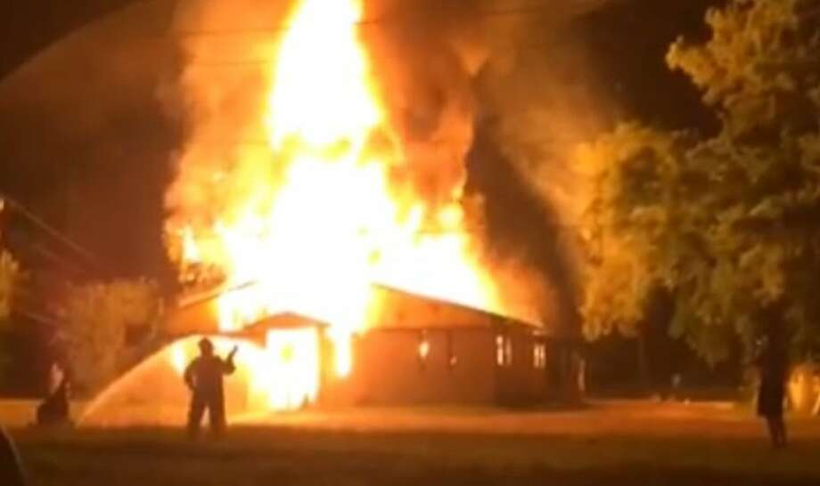 This screen capture taken by a reader-submitted video shows the magnitude of a building fire at US 59 and Boles Road. The fire started around 5 a.m. July 7.