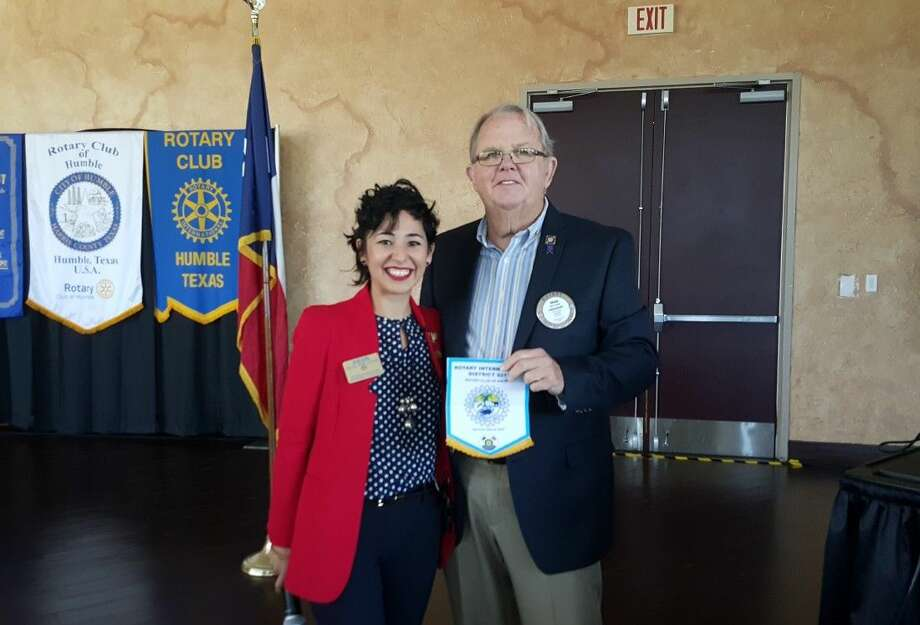 Dr. Isis Mejias and Humble Rotary president Oran Bain pose with a flag gifted on behalf of the Rotary club of Kalisizo, Uganda on Wednesday, Feb. 10.
