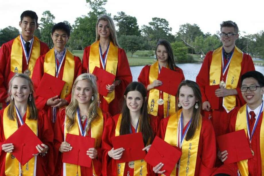 The Atascocita High School 2014 Top 10 graduating seniors wear their red gowns and caps in preparation for the big day May 24.