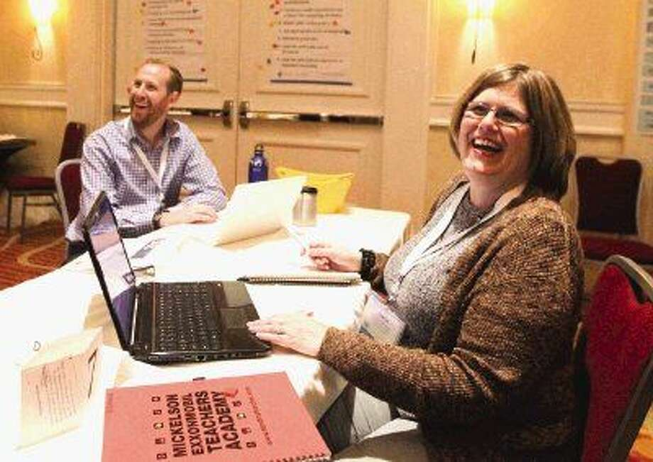 Conroe ISD teachers Dana Canales and Andrew Schleisman share a laugh during the Teachers Academy Thursday.