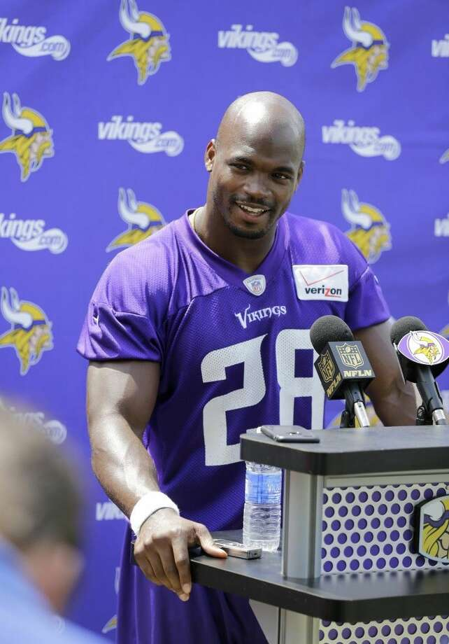 Minnesota Vikings running back Adrian Peterson talks with members of the media after NFL football minicamp in Eden Prairie, Minn., Thursday.