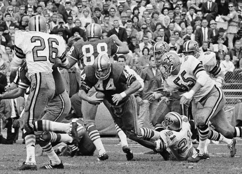 John David Crow, the bruising running back who won the 1957 Heisman Trophy with Texas A&M before a Pro Bowl career in the NFL, died Wednesday night, surrounded by his family, Texas A&M said. He was 79.