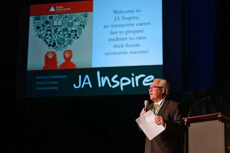 Rick Franke, president of Junior Achievement of Southeast Texas, greets eighth-grade students during the opening session of JA Inspire on Feb. 8.