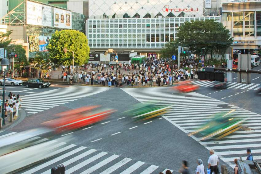 [UNVERIFIED CONTENT] Famous crossroad in Shibuya, Tokyo, Japan aerial view at sunset, cars in motion.