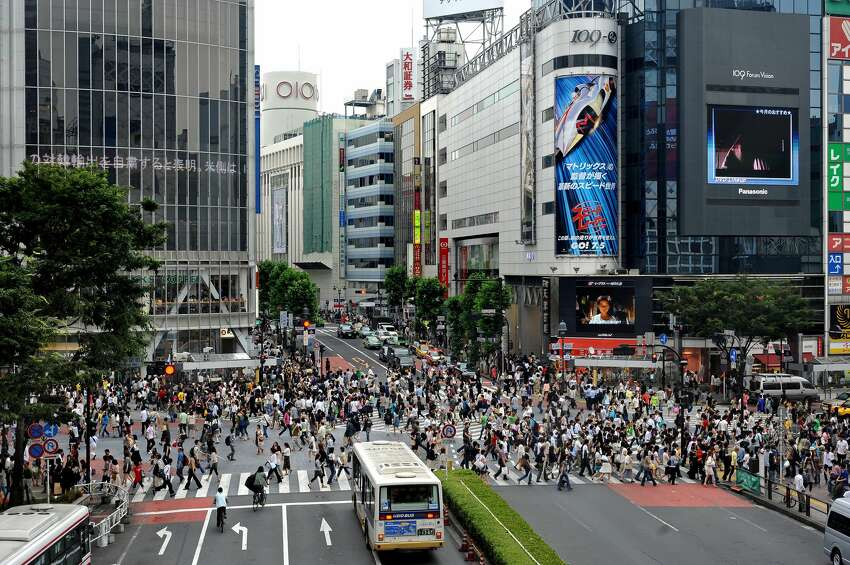 This picture taken on June 21, 2008 shows pedestrians crossing the Shibuya intersection in Tokyo. Shibuya is one of the city's most colorful and busy districts believed to be birthplace to many of the country's fashion and entertainment trends. AFP PHOTO/PHILIPPE LOPEZ (Photo credit should read PHILIPPE LOPEZ/AFP/Getty Images)