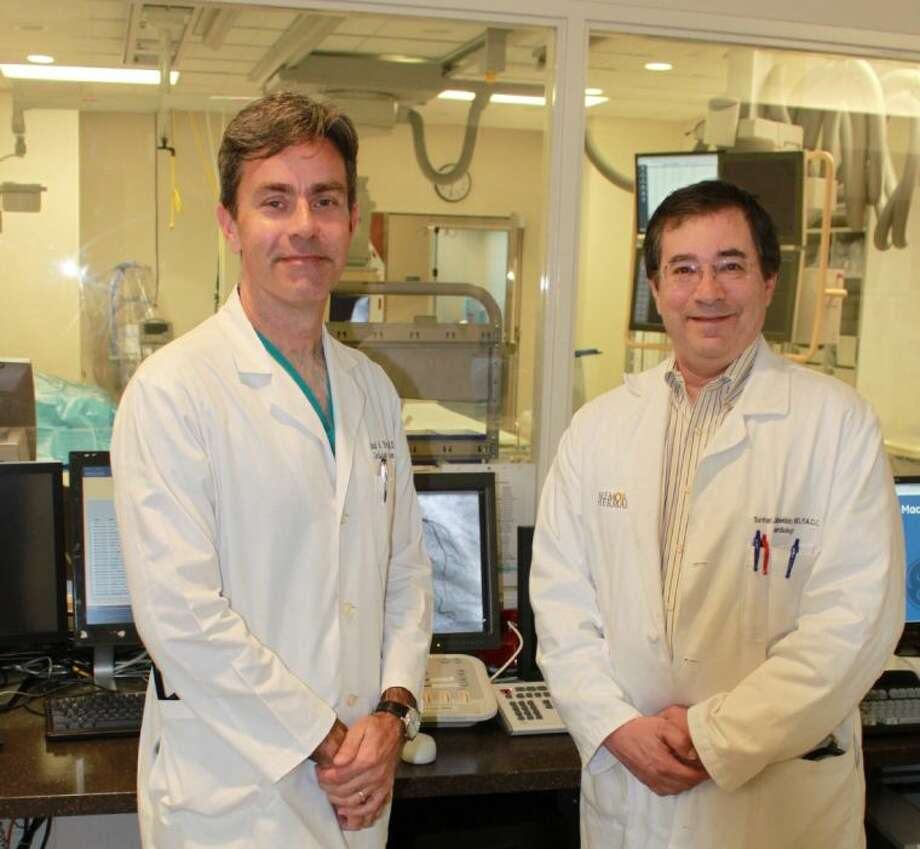 "Previously, fully blocked arteries in the heart were treated either with heart bypass surgery or prescription drugs,"" said David Portugal, M.D., (left) with Sanford J. Lubetkin, M.D. at Memorial Hermann Heart & Vascular Institute-Southwest ""We are excited to now offer a minimally invasive option for patients like Mr. Thomlinson, whose surgically repaired arteries have reclogged, or those who want an alternative to open-heart surgery or are considered too risky for bypass operations. Photo: Submitted Photo"