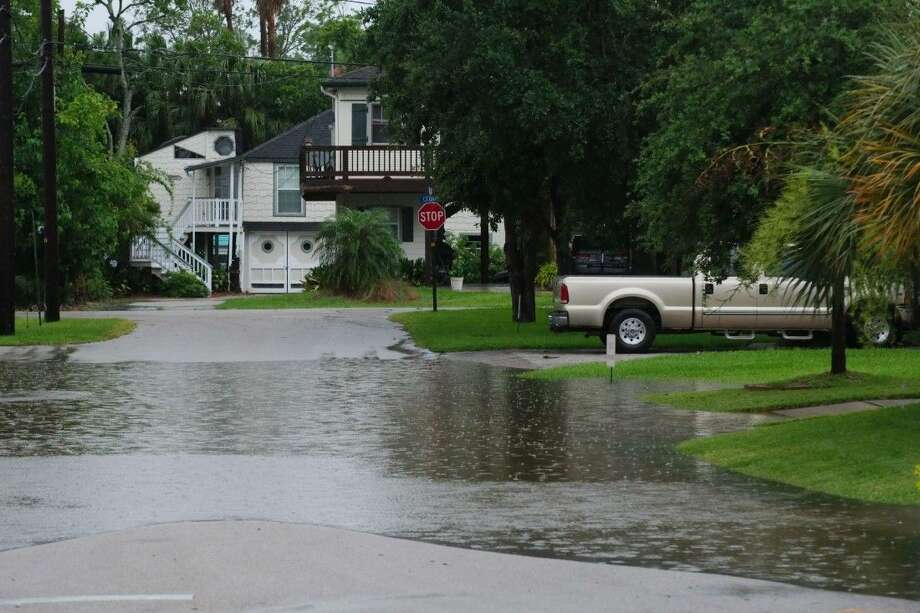 A residential road is submerged under high water in Clear Lake Shores Tuesday.