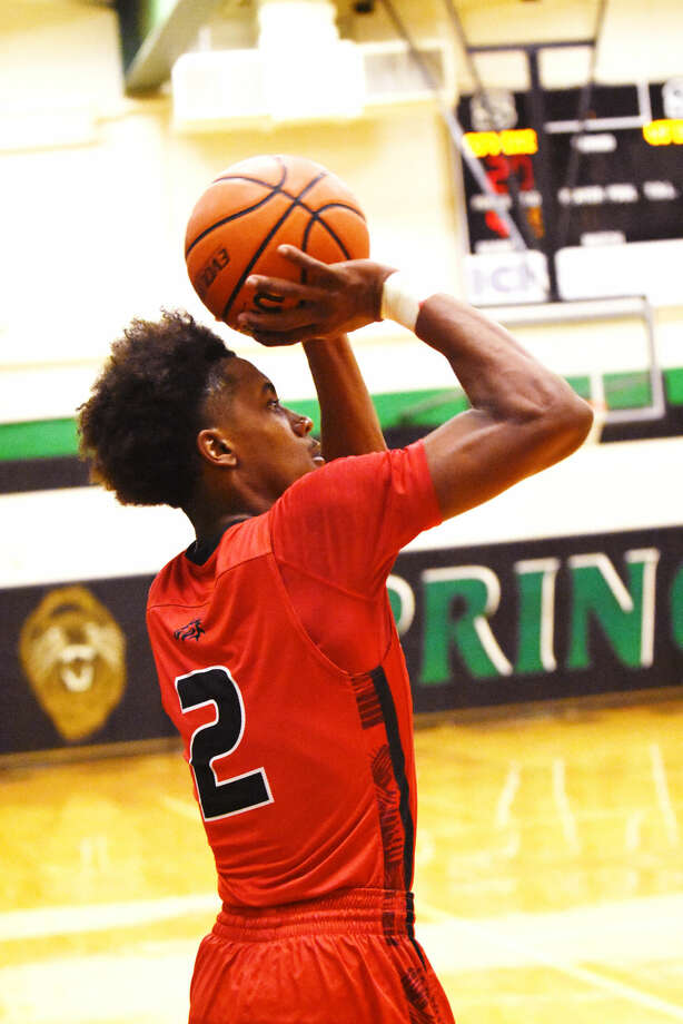 Westfield junior guard Jase Febres fires up a three-point shot Friday, February 12, 2016 at Spring High School. Febres scored a game-high 26 points in the 57-48 win over Spring, connecting on four three-point attempts. Photo: Tony Gaines