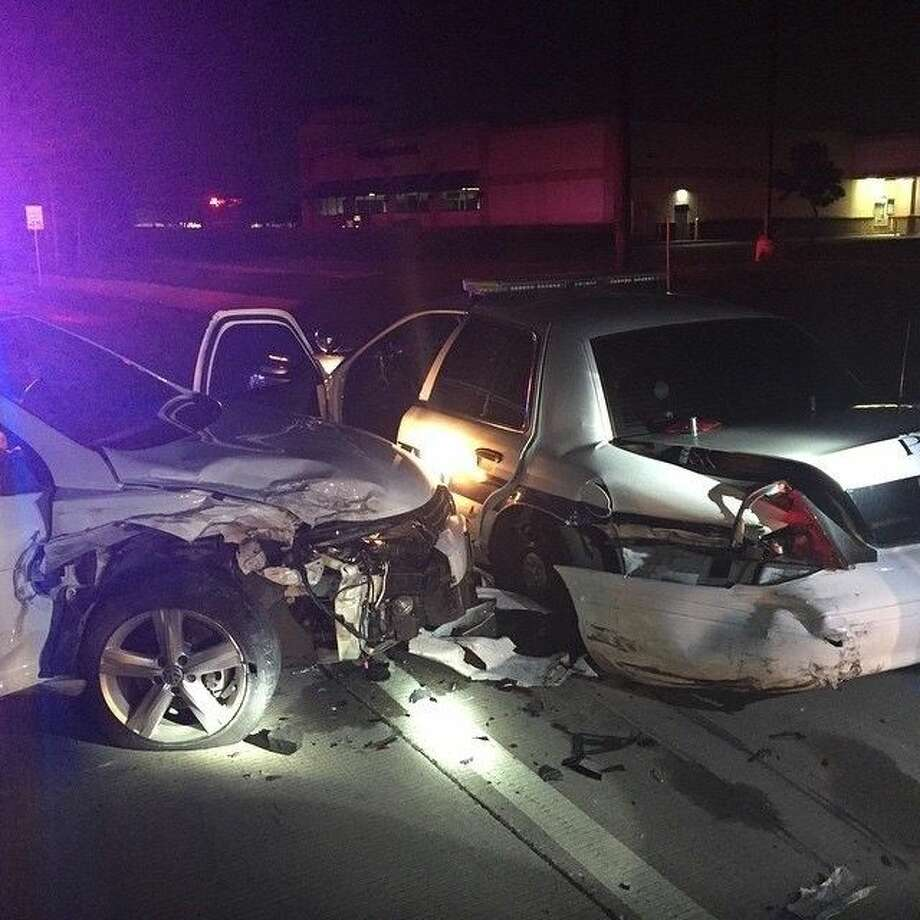 Two Pearland Police Department officers were conducting a traffic stop in the early morning hours of Wednesday (June 17) when a driver slammed into their patrol car.