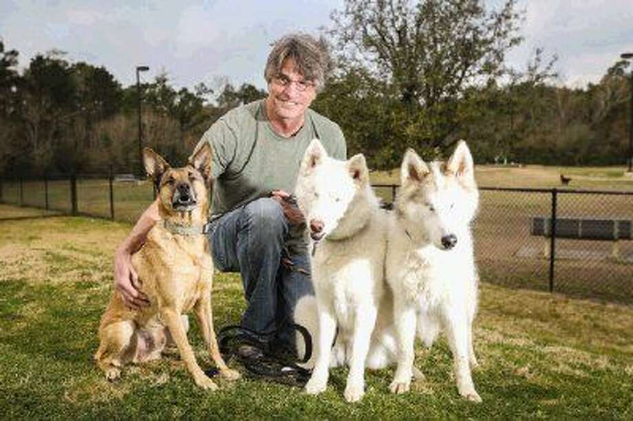 The Woodlands resident Larry Alton adopted Nina, right, and Graham, left, who are unable to see. River, center, who is also blind, is being fostered by Alton. Photo: Michael Minasi