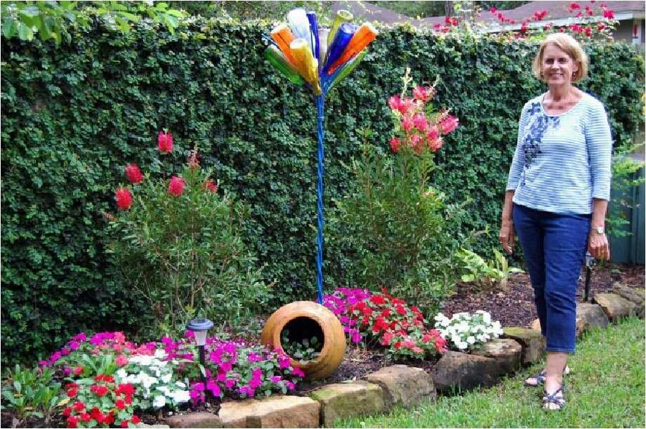 "Before breaking for the summer, Kingwood Garden Club chose Janet Roberts as the recipient of the June ""Yard of the Month Award."""