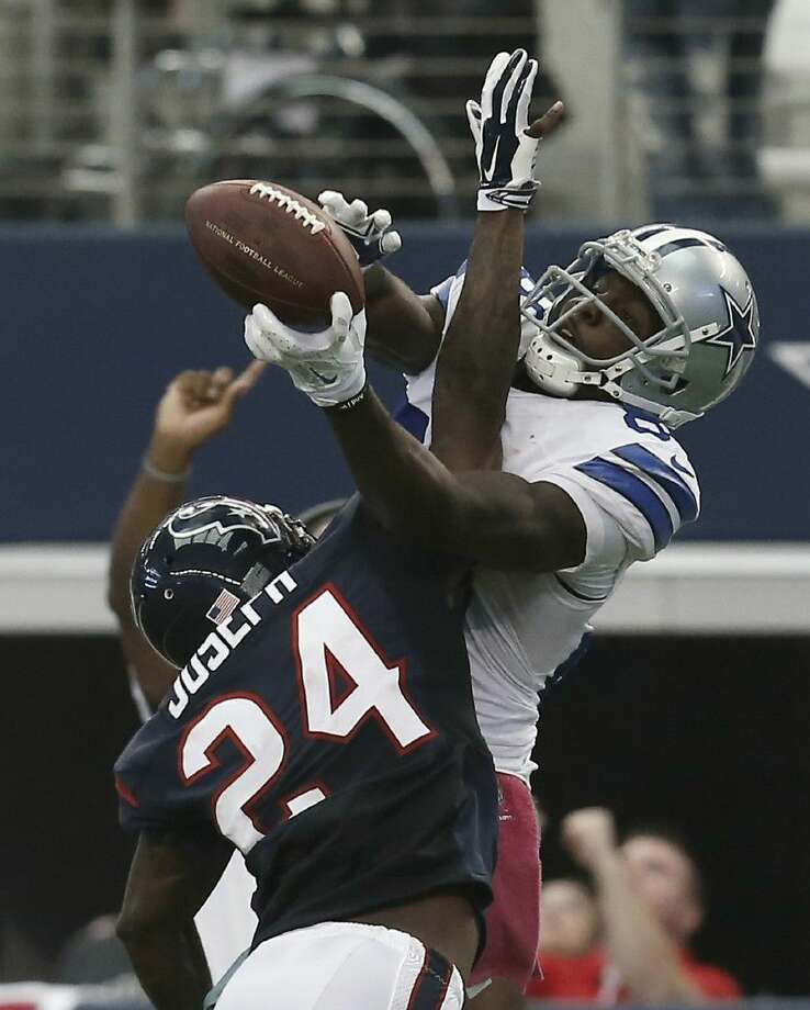 Dallas Cowboys wide receiver Dez Bryant (88) grabs a pass over the Texans' Johnathan Joseph in overtime. The catch led to the Cowboys' 20-17 victory.