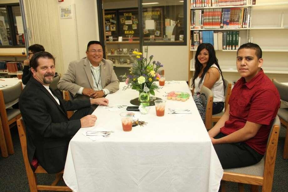Pasadena City Councilman Cary Bass poses with PHS principal Joe Saavedra and students Alexa Hernandez and Frank Hererra.