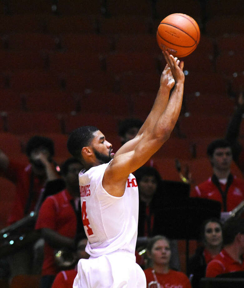 University of Houston senior forward LeRon Barnes fires up a three-point shot Saturday, February 13, 2016 at Hofheinz Pavilion. Barnes scored 13 points in the 82-58 victory over the University of Central Florida, as well as grabbing seven rebounds and dishing out an assist. Photo: Tony Gaines