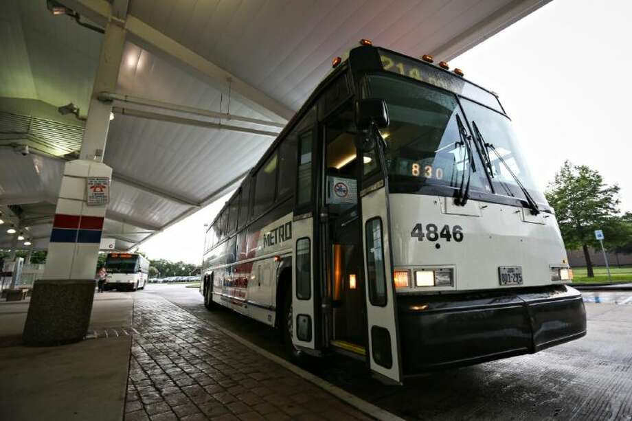 METRO buses await inbound transit passengers on Wednesday morning, June 25, 2014, at the Northwest Park and Ride Station in Houston. Photo: Michael Minasi