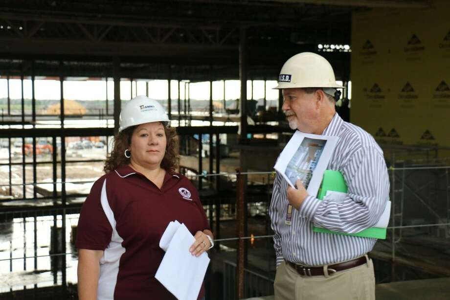 Alvin ISD Board President Cheryl Harris receives an update on the Shadow Creek High School construction from Jeff Couvillion, Alvin ISD director of building programs.